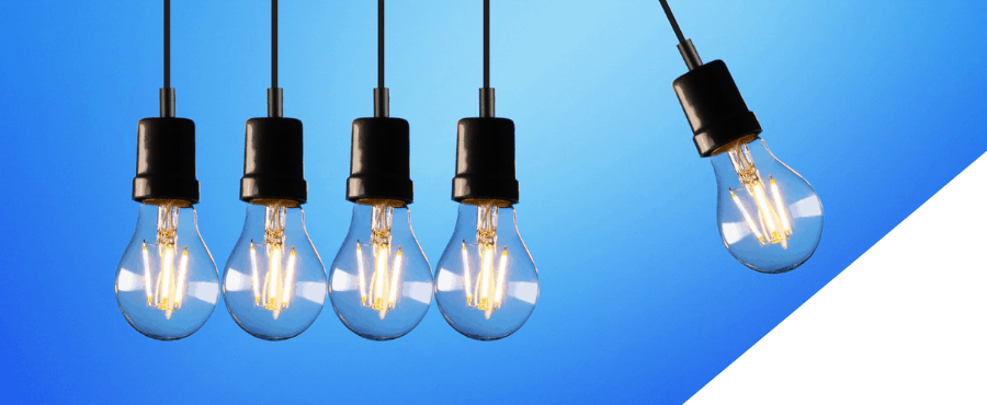 How outsourcing saves cost - article image of swinging lightbulbs